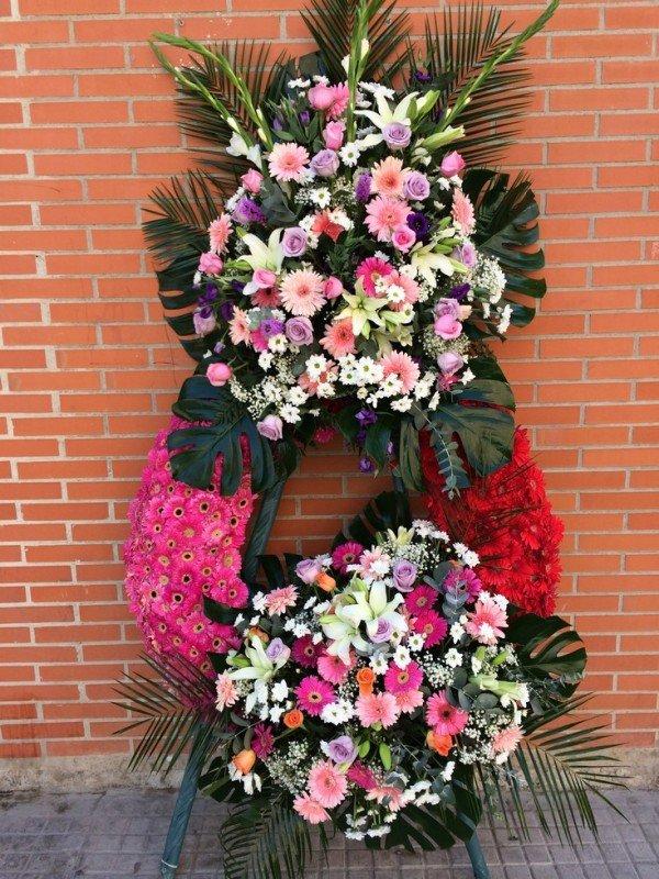 corona fúnebre de flores de tamaño grande con dos centros