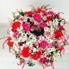Centro en forma de coronita de flor y tonos variados