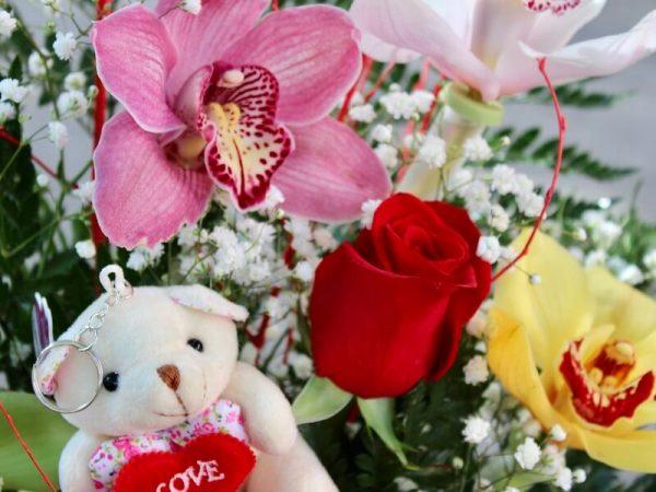 centro de orquideas y rosas rojas para enviar en Torrent